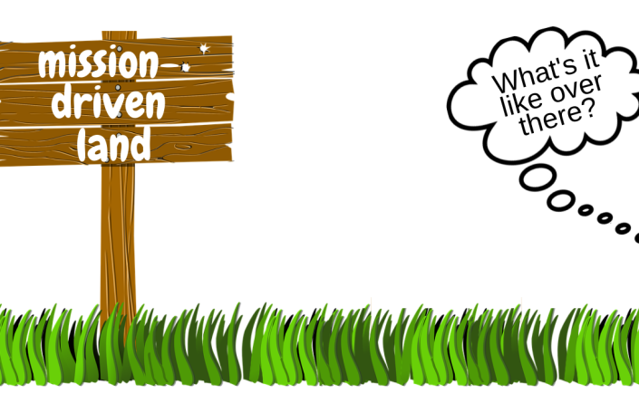 "A wooden sign reads ""mission-driven land"" sits in green grass. A thought bubble says ""What's it like over there?"""